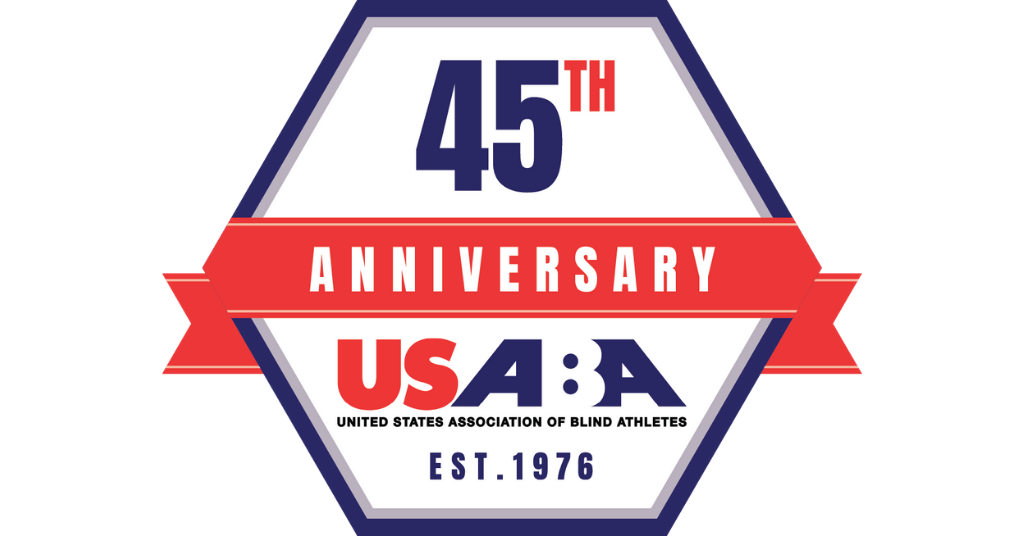 """The USABA 45th-anniversary logo in red, white and blue. """"45th"""" is above a red ribbon that says """"Anniversary"""". Below the ribbon is the USABA logo and """"EST. 1976\"""