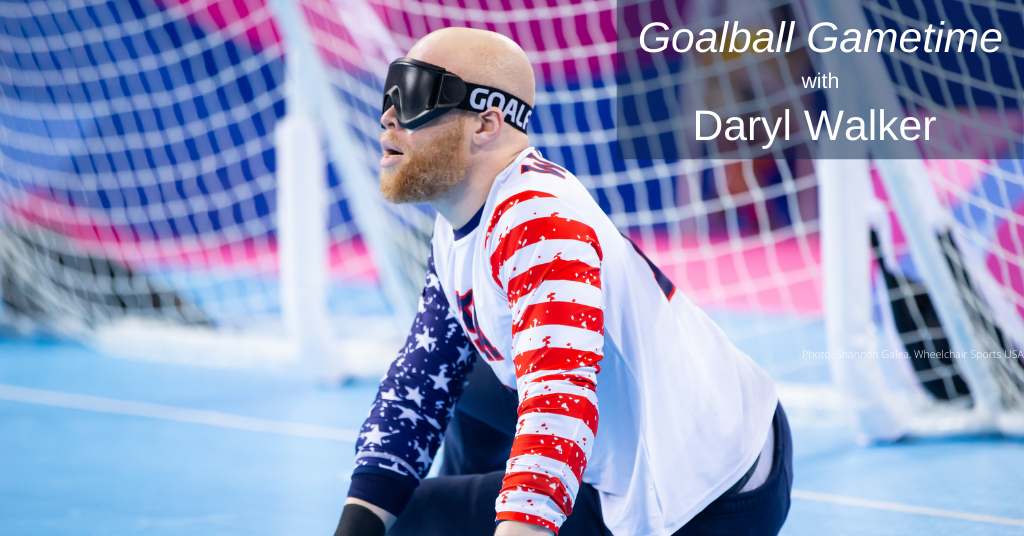 Daryl Walker sits on his left side in front of his goal during competition at the 2019 Parapan American Games in Lima, Peru. He is wearing dark eyeshades, a red, white and blue USA jersey, and tape on his fingers.