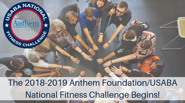 Overhead photo of group of people standing in a circle each with one arm which are all wearing Fitbits extended into the middle of the circle. Text overlay reads the 2018-2019 Anthem Foundation/USABA National Fitness Challenge Begins!