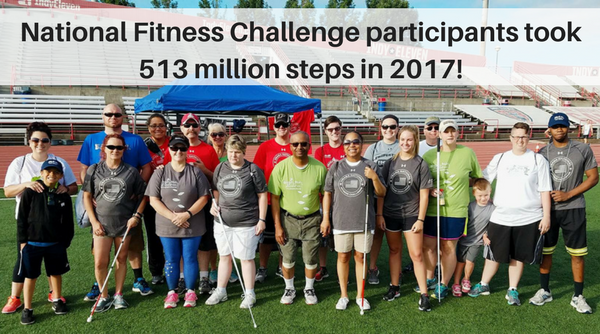 Group photo of National Fitness Challenge participants in matching t-shirts after a 5k race in Indianapolis. Text overlay reads National Fitness Challenge participants walked 245,000 miles in 2017!
