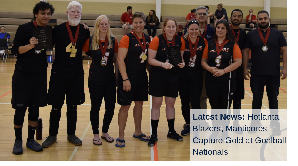The Hotlanta Blazers and Manticores goalball teams pose on the court with their gold medals at the 2019 Goalball National Championships in Smyrna, Georgia