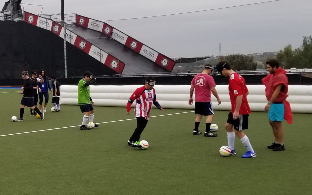 Athletes practice dribbling drills on the field with the 5-a-side soccer balls