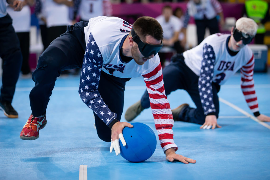 Calahan Young gathers in the goalball after making a stop during the 2019 Parapan American Games in Lima, Peru.