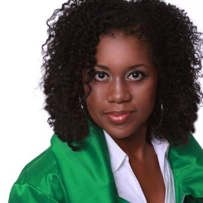A professional headshot of Eve Wright Taylor wearing a shiny green top
