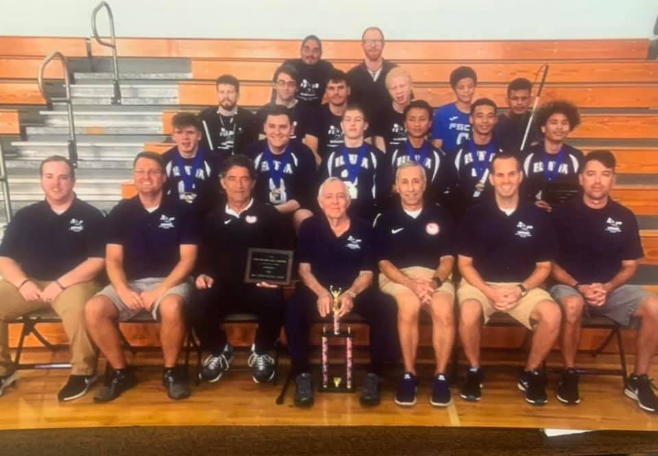 Tom Parrigin (front row center) is pictured with the Florida School for the Deaf and the Blind goalball team at the 2018 Youth National Championships. Current USA Goalball Men's National Team Coach Keith Young is seated far right in the front row.