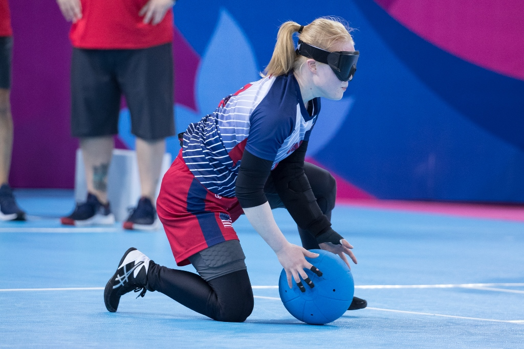 Marybai Huking kneels on her right knee as she gathers in the goalball during the 2019 Parapan American Games in Lima, Peru.