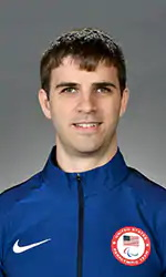 A headshot of Matt Simpson wearing a blue jacket
