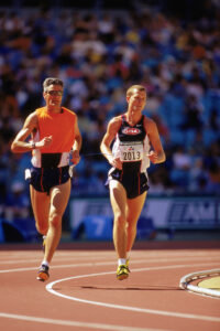 Tim Willis of the USA races with his guide in the Men's 5000m  T11  Final, finshing fourth during the Sydney 2000 Paralympic Games on October 25, 2000 at Olympic Stadium in Sydney, Australia.  (Photo by: Adam Pretty/Getty Images)