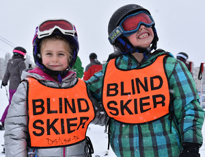 Siblings Zoe and Logan Galloway smile for the camera as they participate in the Anthem Winter Sports Festival in Colorado.